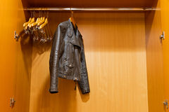 Leather jacket. Hanging symbolic in the closet Royalty Free Stock Photos