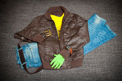 Leather jacket, blue jeans, belt, shirt and watch Royalty Free Stock Photos