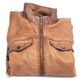 Leather jacket. Closeup of a folded brown worn leather jacket on a white background Stock Photos