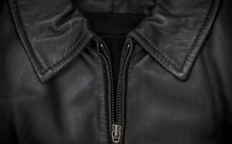 Leather jacket collar and zip. Leather jacket collar and metal zip closeup Royalty Free Stock Photos