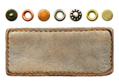Leather jeans label and a set of metal rivets Royalty Free Stock Images