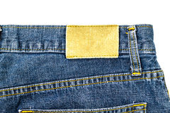 Leather jeans label sewed on jeans. Royalty Free Stock Photography