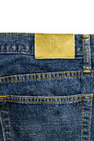 Leather jeans label sewed on jeans. Stock Photos