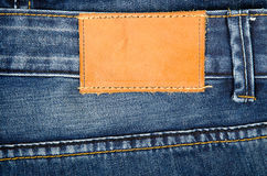 Leather jeans label sewed on jeans Stock Images