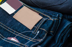 Leather jeans label sewed on jeans. Stock Images