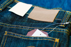 Leather jeans label sewed on jeans. Royalty Free Stock Image