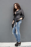 In leather and jeans Stock Photos