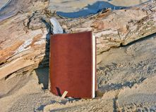Leather journal with feather bookmark Stock Photo