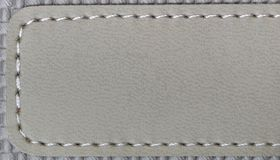 Leather label. Blank grey colored leather label Royalty Free Stock Photography