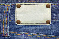 Leather label on jeans Royalty Free Stock Image