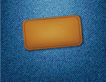 Leather label on jeans background Royalty Free Stock Photo