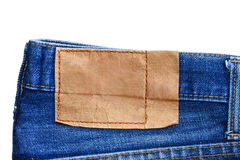 Leather label jeans. Blank leather label back view of jeans isolated on white background Stock Photography