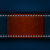 Leather label sewn to jeans Royalty Free Stock Images