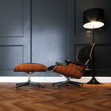 Leather lounge chair in new black interior with wooden parquet f Royalty Free Stock Image