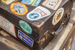 Leather luggage suitcases full of hotel stickers Royalty Free Stock Photos