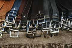 Leather man belts collection in the store. royalty free stock photos