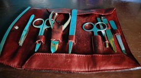 Leather manicure set in red color to take with you when travelling royalty free stock photos