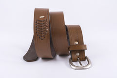 Leather men`s belt. Brown leather men`s belt on a white background Royalty Free Stock Photos