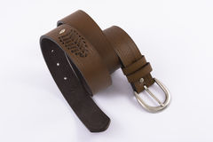 Leather men`s belt. Brown leather men`s belt on a white background Royalty Free Stock Images