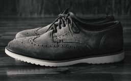 Leather Men`s Brogue Shoes on The Floor in Black & White royalty free stock photos