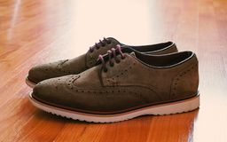 Leather Men`s Brogue Shoes with Colored Laces  on The Floor with Back Light royalty free stock photo
