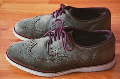 Leather Men`s Brogue Shoes with Colored Laces  on The Floor  Closeup stock photo