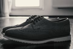Leather Men`s Brogue Shoes on The Floor in Black & White stock photography