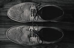Leather Men`s Brogue Shoes on The Floor in Black & White stock photos