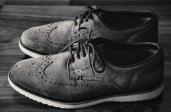 Leather Men`s Brogue Shoes on The Floor in Black & White royalty free stock photo