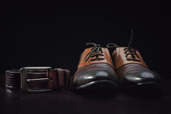 Leather men's dress shoes and belt Royalty Free Stock Photo