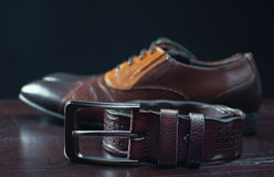Leather men's dress shoes and belt Stock Images