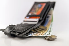 Leather men& x27;s open wallet with euro banknotes bills, coins and c. Redit card inside  on white background Stock Image