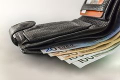 Leather men& x27;s open wallet with euro banknotes bills, coins and c. Redit card inside isolated on white background Stock Image