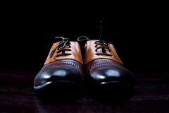 Leather men's shoes on  black background. Leather men's shoes on a black background Royalty Free Stock Photography