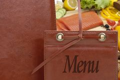 Leather menu in a restaurant Stock Images