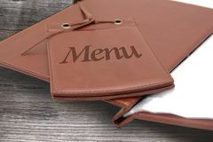Leather menu in a restaurant Stock Image