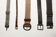Leather and metal belts isolated on a white background stock photos