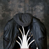 Leather motorcycle jacket and hat Royalty Free Stock Images