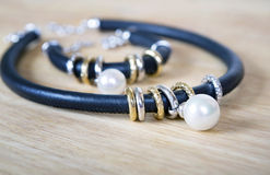 Leather necklace and bracelet with pearl. Stock Images