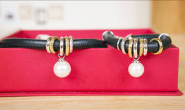 Leather necklace and bracelet with pearl. Stock Photos