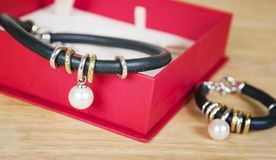 Leather necklace and bracelet with pearl. Royalty Free Stock Photo
