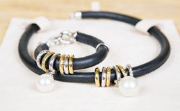 Leather necklace and bracelet with pearl. Royalty Free Stock Photography