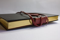 Leather Notebook. A black leather notebook against a white background Royalty Free Stock Photo