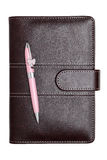 Leather notebook and ballpoint pen Royalty Free Stock Images