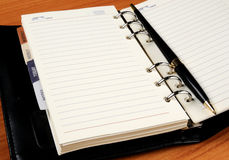 Leather notebook with black pen Stock Photography