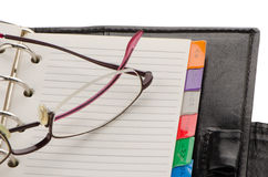 Leather notebook and glasses Stock Photography