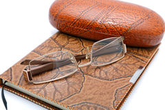Leather  notebook and glasses isolated Royalty Free Stock Photo