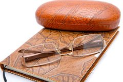Leather  notebook and glasses  on a white background Royalty Free Stock Image