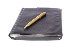 Leather notebook with pen Royalty Free Stock Photo