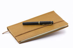Leather notebook and pen isolated Royalty Free Stock Images